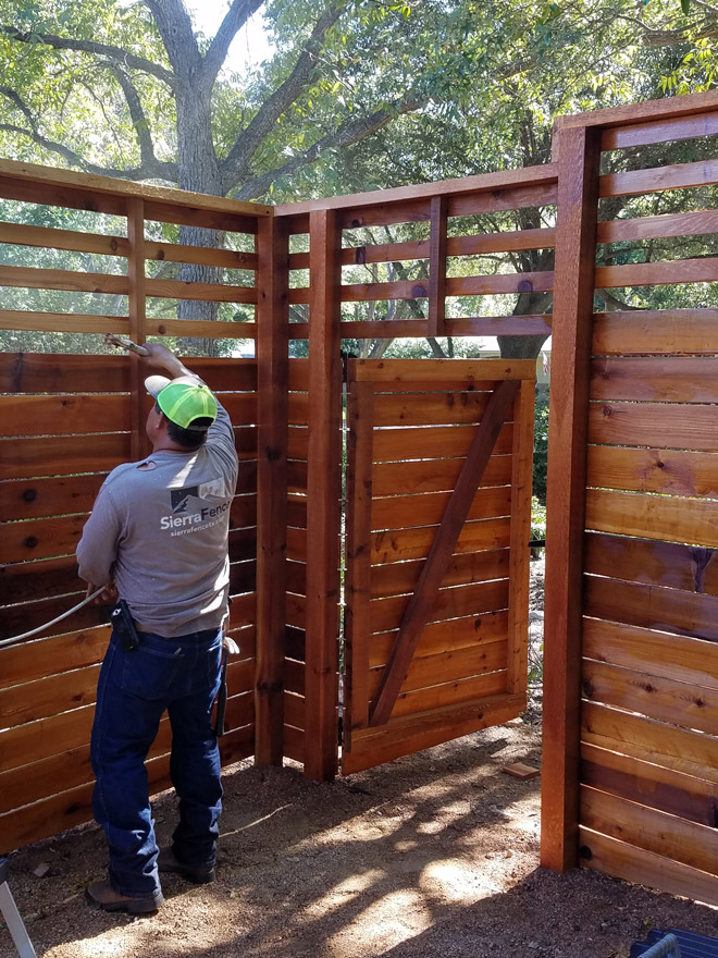 Staining 8 Foot Tall Custom Horizontal Fence with Slats on Top