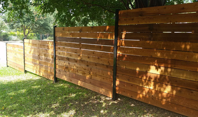 horizontal style fence with black posts stained