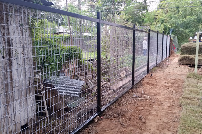 welded horse panel fence with black frame