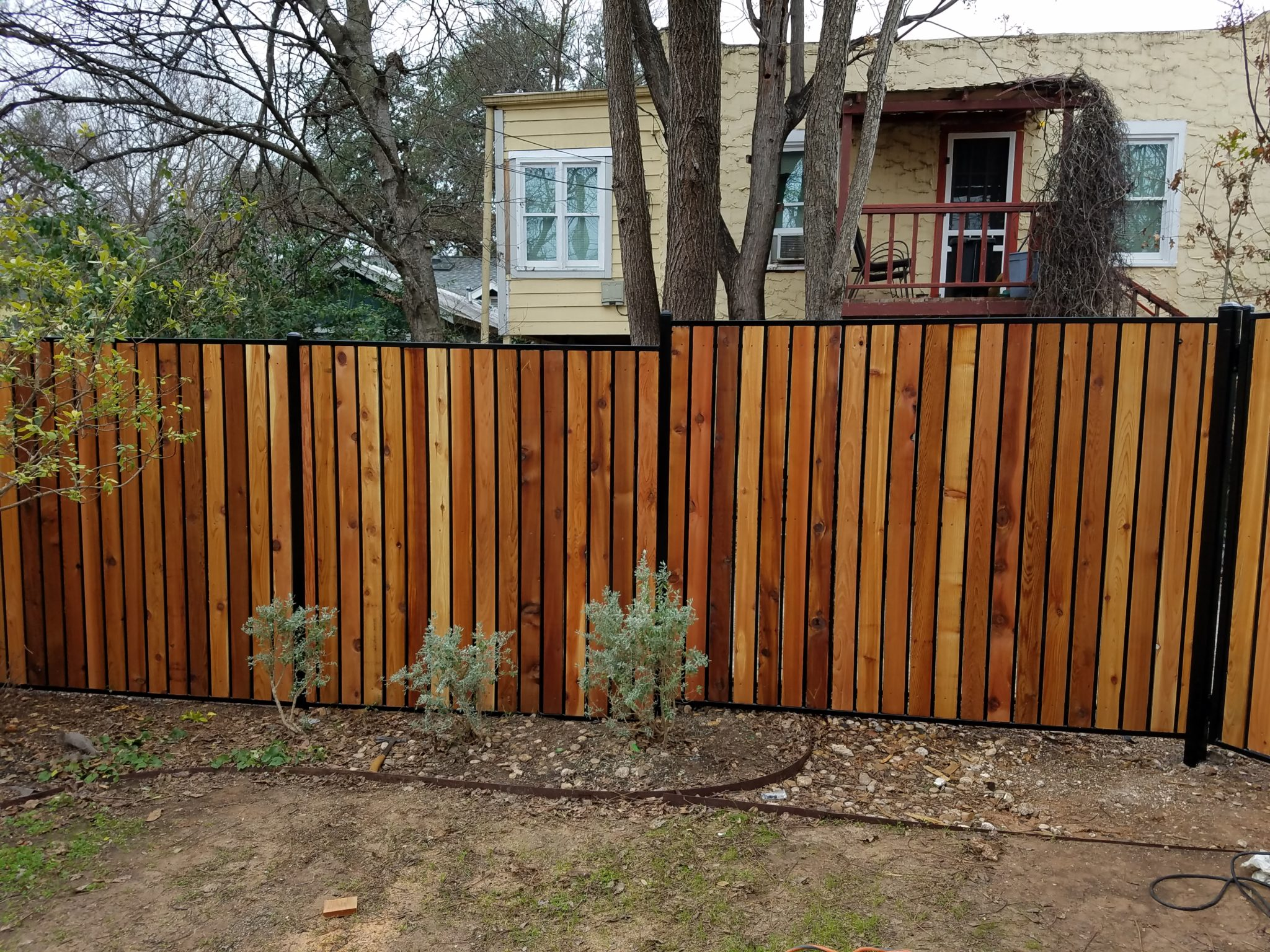 custom metal and cedar fence